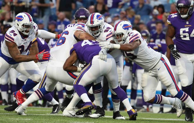 Buffalo Bills defensive end Eddie Yarbrough (75) tackles Minnesota Vikings running back Bishop Sankey (43) in the second quarter.(James P. McCoy/Buffalo News)