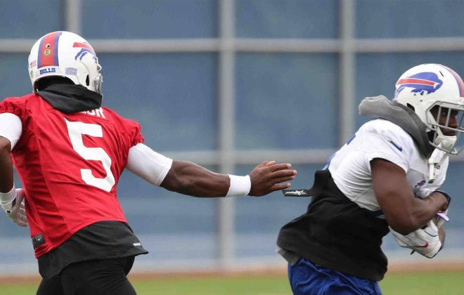 Running back LeSean McCoy takes a hand off from quarterback Tyrod Taylor during practice Friday for the Buffalo Bills. (James P. McCoy/Buffalo News)