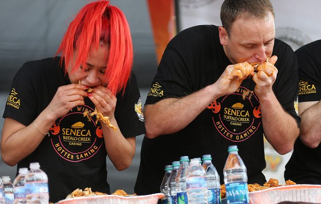 Joey Chestnut, right, the world's top competitive eater, will vie for his first world kale-eating crown in Western New York on Sunday. The Buffalo region is familiar territory to the 33-year-old from San Jose, Calif., pictured above with fifth-ranked competitive eater Miki Sudo during the 2014 U.S. Chicken Wing Championship at Coca-Cola Field in downtown Buffalo. Chestnut has won that contest three years in a row. (Buffalo News file photo)