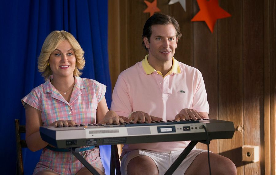 """Amy Poehler and Bradley Cooper in the Netflix original series """"Wet Hot American Summer: First Day Of Camp."""" (Saeed Adyani/Netflix/TNS)"""