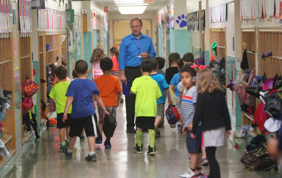 Kindergarten students walk with their teacher Alan Miller at Maple East Elementary in the Williamsville Central School District in this file photo from May 7, 2015.    (Mark Mulville/Buffalo News)