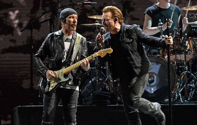 The Edge, left, Bono and the rest of U2 will be at New Era Field on Sept. 5. (Getty Images)