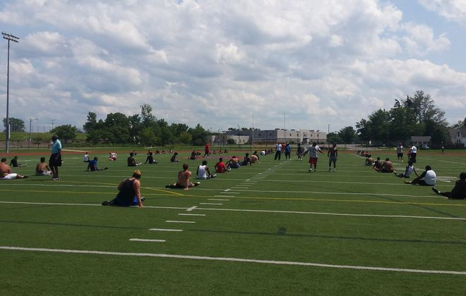 Bennett players do some stretching during their first practice of the season at All High Stadium