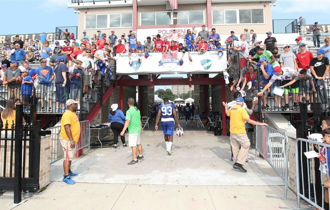 Bills players say goodbye to the fans on the last day of training camp at St. John Fisher College. (James P. McCoy/Buffalo News)