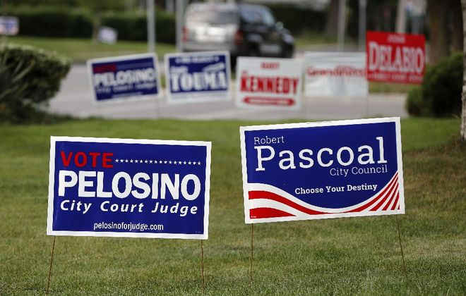 Election signs on the lawn of a home in Niagara Falls in August 2017. (Mark Mulville/Buffalo News)