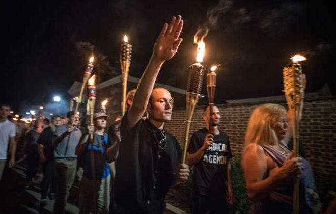 Several hundred white nationalists and white supremacists carrying torches marched in a parade through the University of Virginia campus on Friday. (Washington Post)