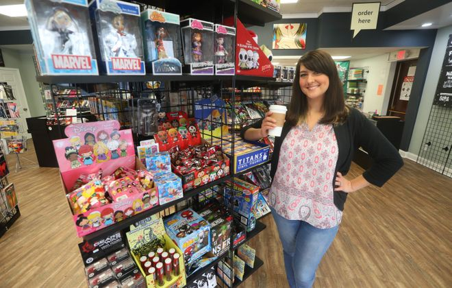 """Amy Berent, owner of Pulp 716 Coffee and Comics at 31 Webster St., North  Tonawanda, is eager to see """"Captain Marvel"""" on the big screen. (John Hickey/Buffalo News file photo)"""