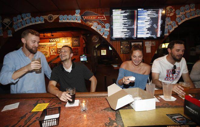 Mister Goodbar regulars from left are Michael Marvin, Scott Christie, Madeline Hall and Jackson Taylor, of Buffalo. (Sharon Cantillon/Buffalo News)
