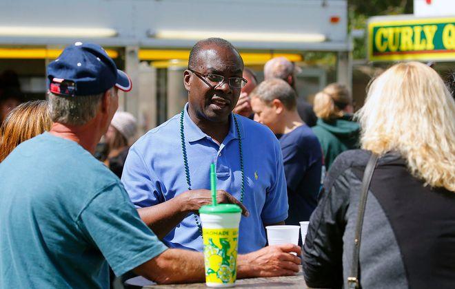 Buffalo Mayor Byron Brown speaks with voters at the Irish Festival at Cazenovia Park in South Buffalo Saturday, Sept. 2, 2017. (Mark Mulville/Buffalo News)