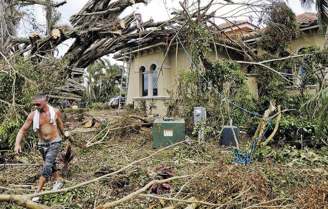 Crews work Friday in Naples to clean up debris, downed power lines, broken trees, following Hurricane Irma. (Robert Kirkham/Buffalo News)
