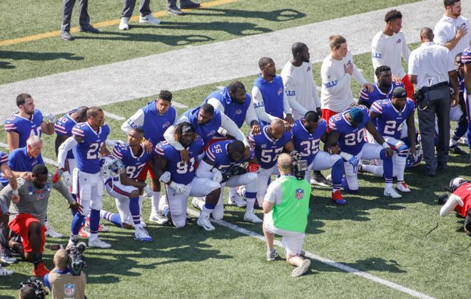 Buffalo Bills players take a knee during the national anthem before the start of the game against the Denver Broncos at New Era Field on Sept. 24. (Derek Gee/Buffalo News)
