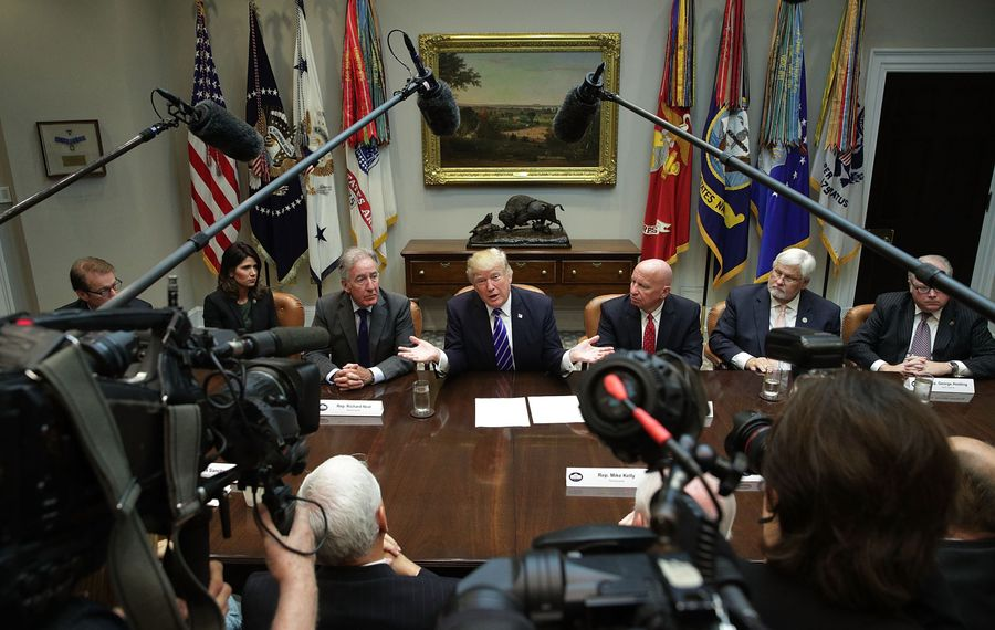 President Trump speaks during a meeting with members of the House Ways and Means Committee as committee chairman Rep. Kevin Brady (R-TX) (R) and ranking member Rep. Richard Neal (D-MA) (L) listen September 26, 2017 at the Roosevelt Room of the White House in Washington, DC. President Trump met with members of the committee to discuss tax reform. (Getty Images)
