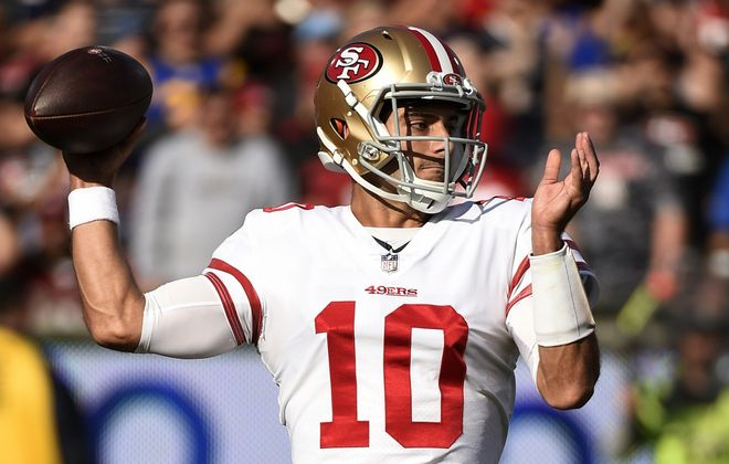 Quarterback Jimmy Garoppolo has led the 49ers to the Super Bowl despite not being asked to throw the ball a lot during the postseason. (Getty Images)