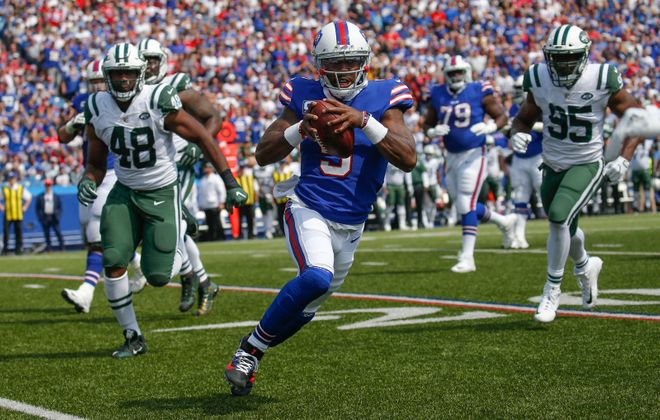 Buffalo Bills quarterback Tyrod Taylor scrambles for yards against the New York Jets during the first quarter at New Era Field in Orchard Park, Sunday. (Robert Kirkham/Buffalo News)