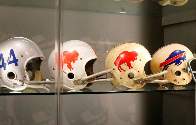 """Buffalo Bills helmets throughout the years were featured in an exhibit in the """"Hall of Honor"""" at Arrowhead Stadium in Kansas City, Mo., in August 2014. (Derek Gee/Buffalo News file photo)"""