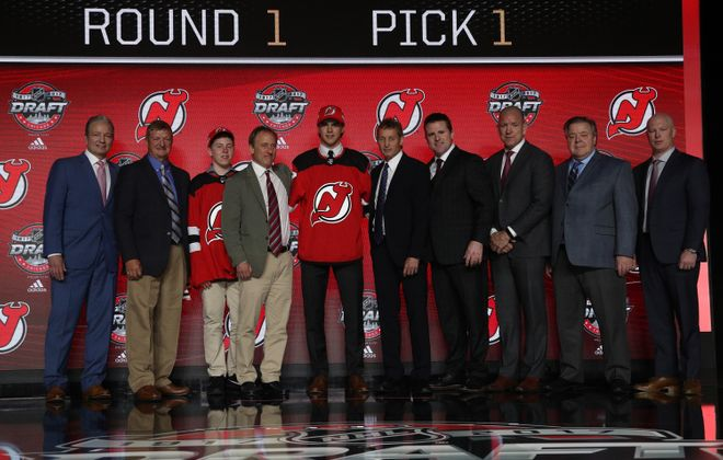 The Devils' Nico Hischier, center in jersey, is one of eight first-round picks in the Sabres' Prospect Challenge. (NHLI via Getty Images)