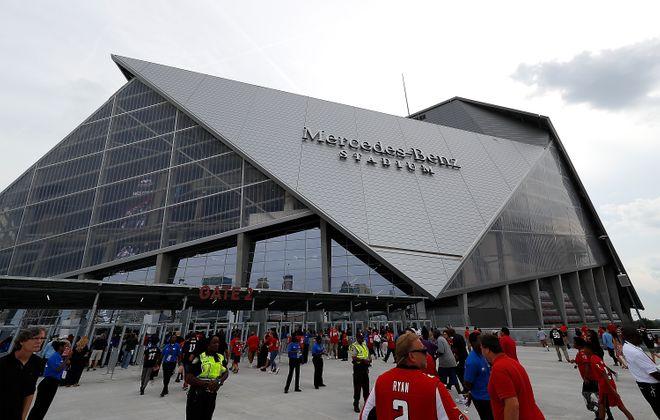 Fans enter the gates at Mercedez Benz Stadium  (Kevin C. Cox/Getty Images)