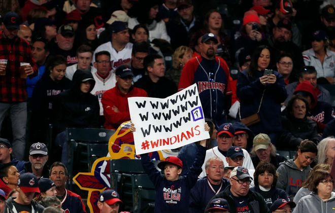 CLEVELAND, OH - SEPTEMBER 10:  Cleveland Indians fans hold signs supporting the Indians' win streak in the ninth inning against the Baltimore Orioles at Progressive Field on September 10, 2017 in Cleveland, Ohio. The Indians defeated the Orioles 3-2, and their win streak now stands at 18.  (Photo by David Maxwell/Getty Images)
