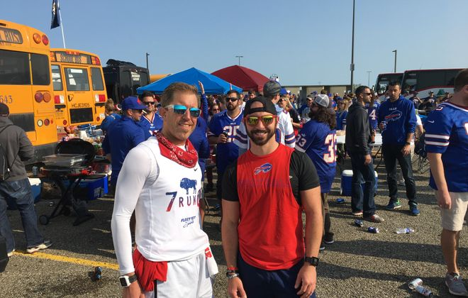 Paul Szablicki, left, and Brian Goldsmith avoided gameday traffic by running to Sunday's home opener. Goldsmith ran 15 miles from North Buffalo, and Szablicki joined him in South Buffalo for the final 7.5 miles. (Jonah Bronstein/Special to The News)