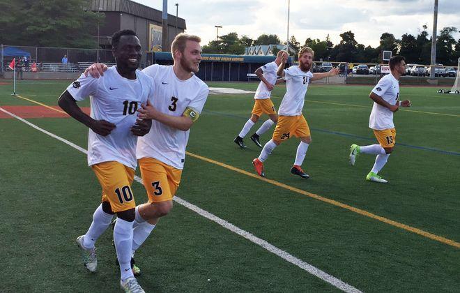 Canisius' Melvin Blair (10) is congratulated by Bjarki Benediktsson after a goal. (Ben Tsujimoto/Buffalo News)