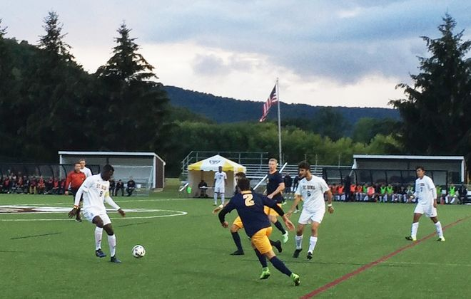 Canisius, in blue, defends an attack by St. Bonaventure. (Ben Tsujimoto/Buffalo News)