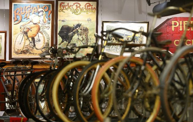 Some of the bicycles and memorabilia on display at the Buffalo Transportation/Pierce Arrow Museum in Buffalo. (Mark Mulville/Buffalo News)