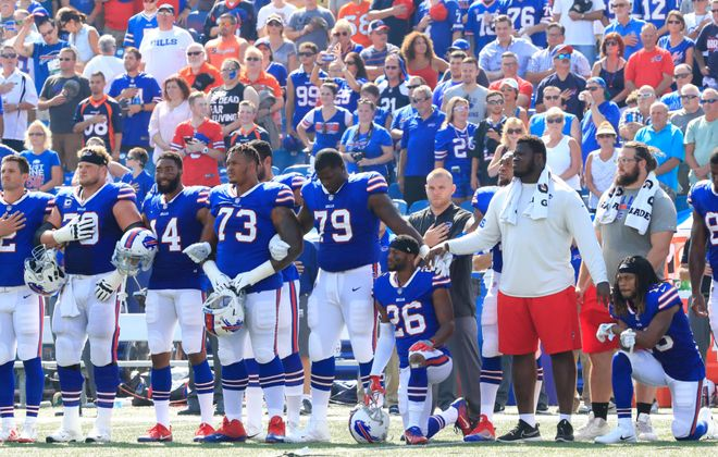 Bills players during the national anthem before a late September game (Harry Scull Jr./Buffalo News file photo)