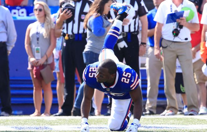 LeSean McCoy went through a stretching routine during the playing of the National Anthem, sometimes sitting, sometimes standing and jumping, and taking a knee towards the end of the song, before walking to the sideline as the singer held the last note. (James P. McCoy/Buffalo News)