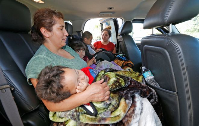 Viridiana Hernandez checks on her children and her mother at a Shell station in Daphne, Ala., as the family heads back to Florida after visiting with family in Fort Worth, Texas, when Hurricane Irma blew toward their home.  (Robert Kirkham/Buffalo News)