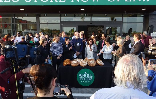 Customers line up as officials prepare to open the much-anticipated opening of Whole Foods in Amherst. (John Hickey/ Buffalo News)