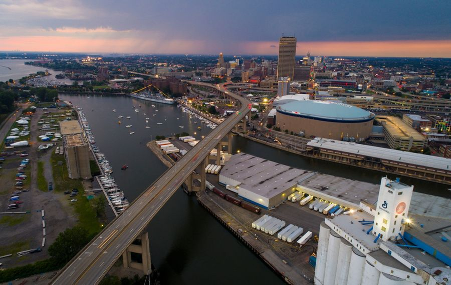 A rain shower over the Northtowns backdrops a view of the Buffalo River and downtown Buffalo. (Derek Gee/Buffalo News)