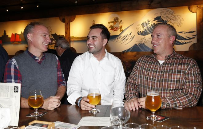 From left, in Sato Brewpub, are Mark Gamble of the City of Tonawanda, Paul Stanek of Buffalo and Mike Kaizer of Hamburg. (Sharon Cantillon/Buffalo News)