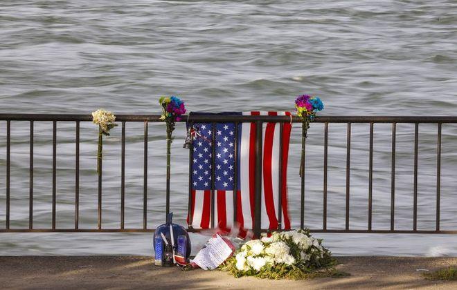 A memorial to fallen Buffalo Police Officer Craig Lehner at the edge of the Niagara River in Broderick Park. (Derek Gee/Buffalo News)