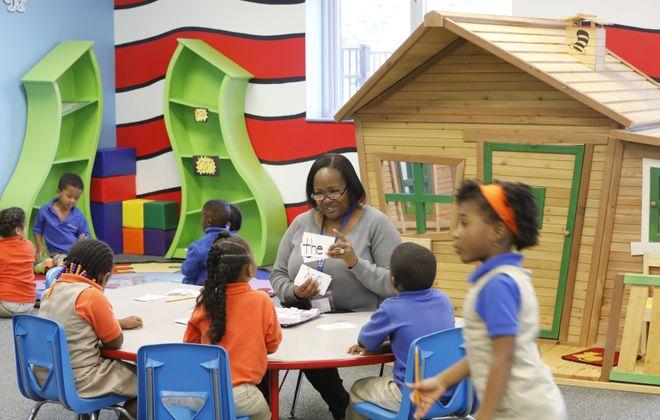 "Teacher assistant Donna Jones runs through flash cards with ""sight words"" on them during kindergarten glass in the Dr. Seuss Room REACH Academy Charter School on Tuesday, Oct. 10, 2017. (Derek Gee/Buffalo News)"