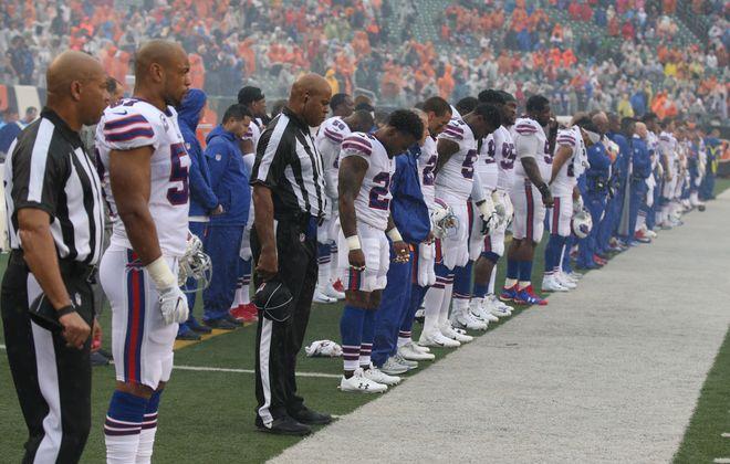 All of the Buffalo Bills stood for the national anthem Sunday. (James P. McCoy / Buffalo News)