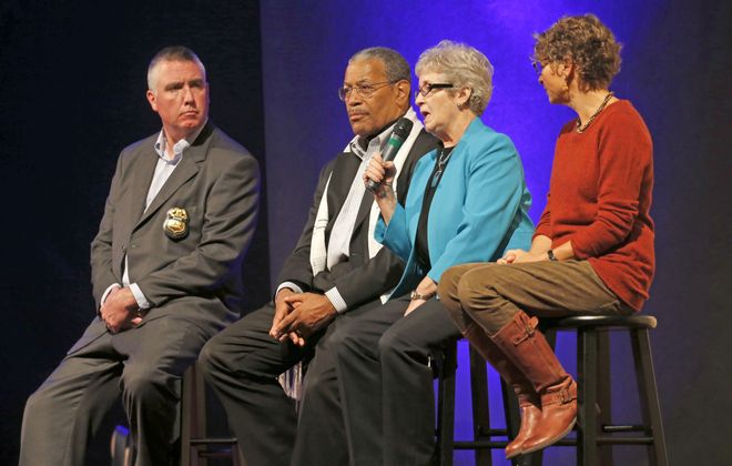 A panel of opioid abuse experts and community leaders speak at Eastern Hills Church in Clarence on Sunday. (Robert Kirkham/Buffalo News)