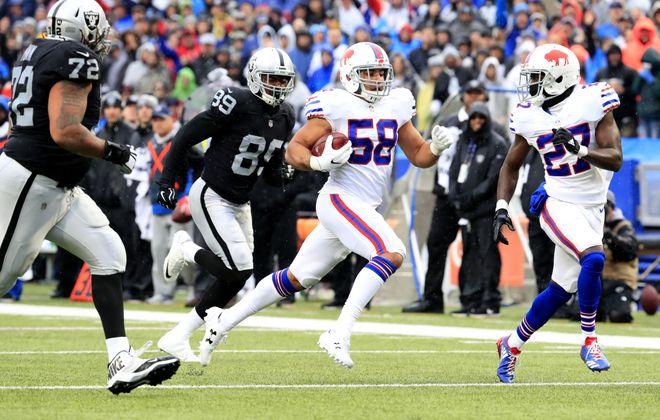 Buffalo Bills rookie Matt Milano returns an Oakland Raiders fumble for a touchdown. (Harry Scull Jr./Buffalo News)