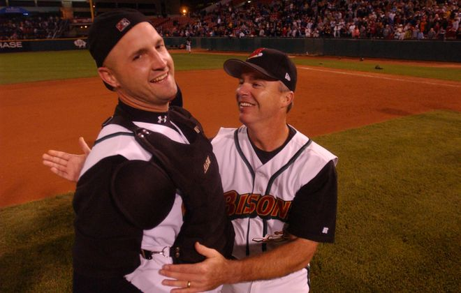 Catcher Dusty Wathan, left, celebrates with manager Marty Brown after the Bisons' 6-1 win over Richmond clinched the International League title at then-Dunn Tire Park on Sept. 17, 2004 (Mark Mulville/News file photo).