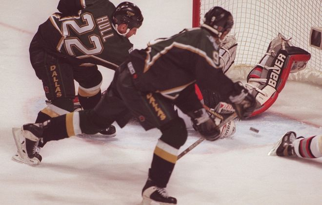 "The Dallas Stars' Brett Hull scores the infamous ""No Goal"" in the third overtime of Game 6 of the 1999 Stanley Cup Finals. (Mark Mulville/News file photo)"
