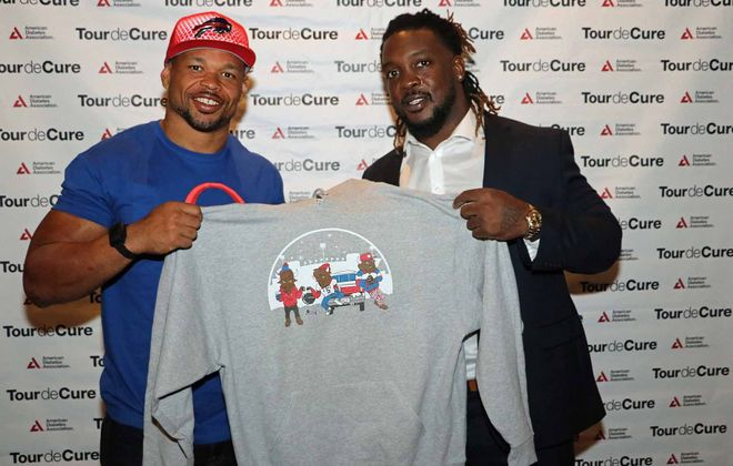 Buffalo Bills players Lorenzo Alexander, left, and Cedric Thornton hosted a Monday Night Football watch party at Anchor Bar to benefit the American Diabetes Association on Monday, Oct. 23. (Photo courtesy of Mikel Burns/American Diabetes Association)