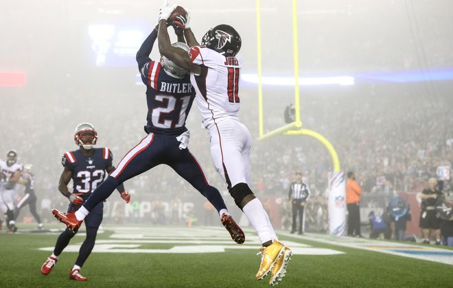 Julio Jones of the Atlanta Falcons catches a touchdown pass as he is defended by Malcolm Butler of the New England Patriots on Oct. 22, 2017. (Getty Images)
