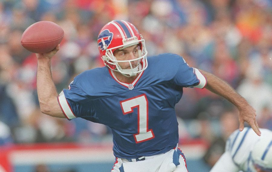 Doug Flutie sidearms a pass to Andre Reed for a first down in the Nov. 11, 1998, Bills game. (News file photo)