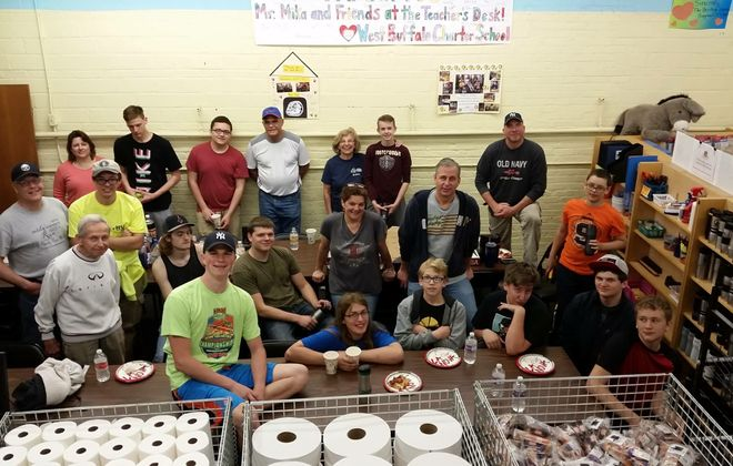 Christopher Kaszynski, front and center working on his Eagle Scout project with other scouts and family members. Scoutmaster Don Hourigan, far left, front row