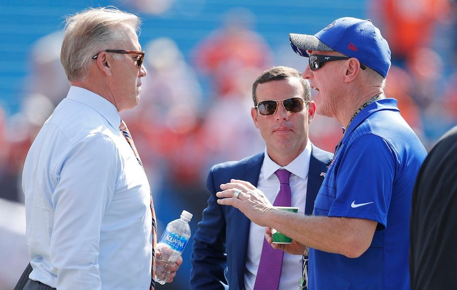 Bills General Manager Brandon Beane, middle, had a deal in place with Broncos GM Josh Elway, left, but Denver backed out during the first round of the NFL Draft. (Mark Mulville/Buffalo News)