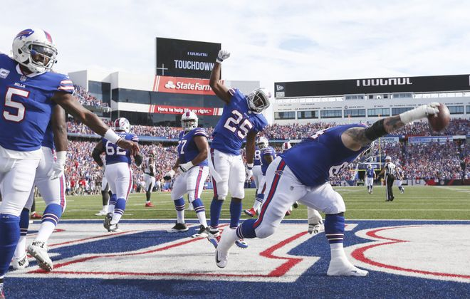 Buffalo Bills offensive guard Richie Incognito (64) spikes the ball after Buffalo Bills running back LeSean McCoy (25) rushed for a touchdown in the fourth quarter Sunday at New Era Field in Orchard Park.  (James P. McCoy / Buffalo News)
