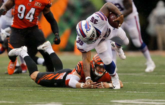 CINCINNATI, OH - OCTOBER 8:  Mike Tolbert #35 of the Buffalo Bills breaks the tackle by Nick Vigil #59 of the Cincinnati Bengals during the second quarter at Paul Brown Stadium on October 8, 2017 in Cincinnati, Ohio. (Photo by Michael Reaves/Getty Images)