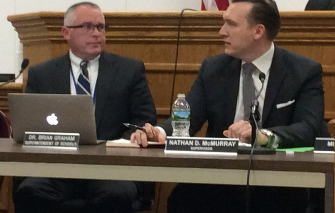 Superintendent Dr. Brian Graham (left) and Town Supervisor Nathan D. McMurray (right) lead a joint town and school board meeting