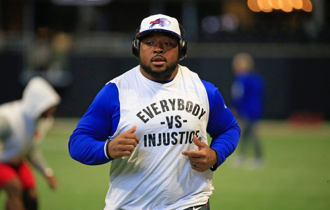 Bills running back Mike Tolbert took a knee during the playing of the national anthem Sunday. (Harry Scull Jr./Buffalo News)