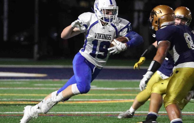 Grand Island's Thomas Cecere runs in a 28-0 Vikings victory at Sweet Home. (James P. McCoy/Buffalo News)