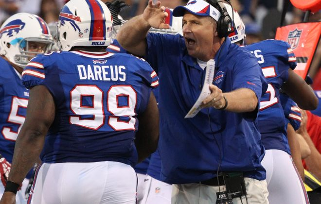 Doug Marrone and Marcell Dareus pictured in 2013.(James P. McCoy/News file photo)